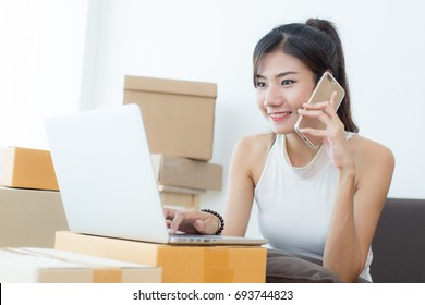 Young Asian Woman Working at home, Young Owner Woman Start up for Business Online, SME, Delivery Project, Woman with Online Business or SME Concept.