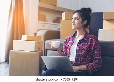 Young Asian Woman Working at home, Young Owner Woman Start up for Business Online, SME, Delivery Project, Woman with Online Business or SME Concept. Vintage tone.