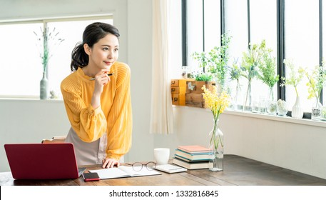Young asian woman working in the office.