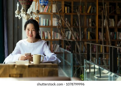 Young Asian women in the cafe