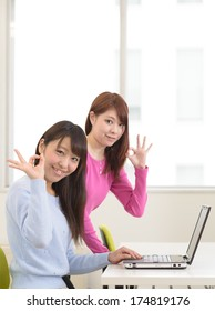Young asian women in casual clothes working on laptop computer