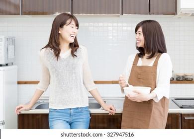 young asian women relaxing in the kitchen
