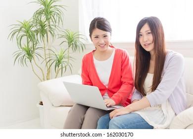 young asian women relaxing on the sofa