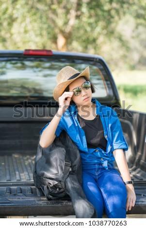 1b61b10a60 Young asian women short hair wear hat and sunglasses carry her guitar bag