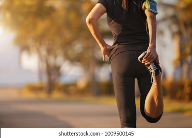 Young asian women walking on a running track.relaxing and exercise concept.