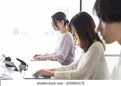 Young asian women working in the office.