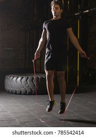 Young athlete doing jump rope exercises
