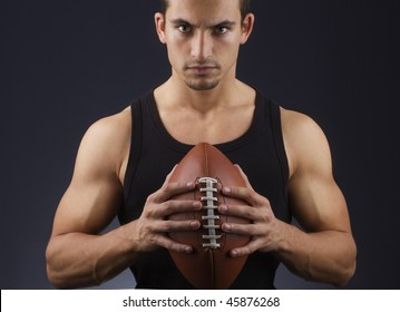 young athlete holding a football ball