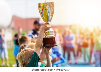 Young Athlete Holding Trophy. Youth Sport Soccer Team with Trophy.