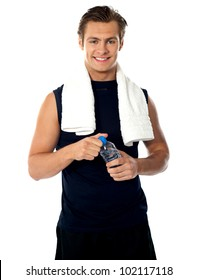 Young athlete posing with bottle of mineral water