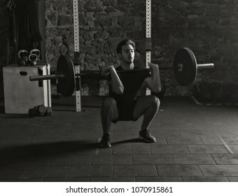 Young athlete practicing heavy lifts