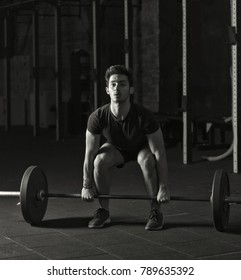 Young athlete practicing olympic lifts