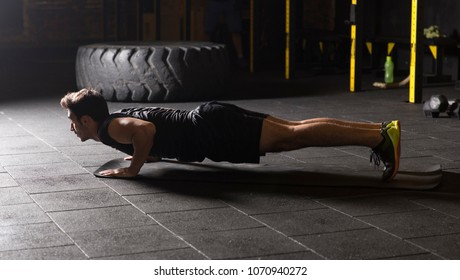 Young athlete practicing push ups