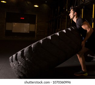 Young athlete practicing tire flips