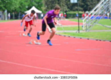 A young athlete in a relay race; blur effect for a sports-style background.