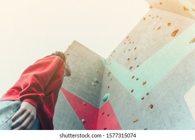 Young athlete rock climber in front of the wall. Street sport 20-29 years old.