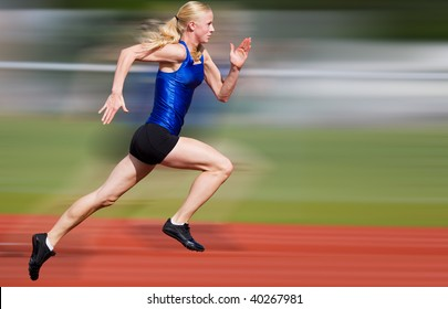 Young athlete running down the track with motion blur added