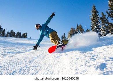 A young athlete is snowboarding. Sunny day at the ski resort in Bulgaria, Borovets