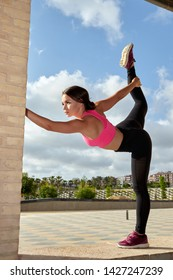 young athlete woman doing stretching in the park