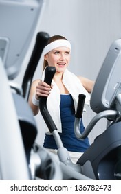 Young athlete woman training on gym training in gym