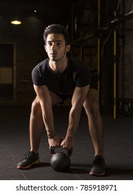 Young athlete working on kettlebell swings