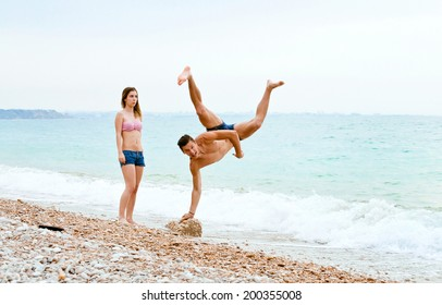 young athletic couple having fun on the beach