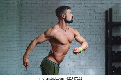 Young athletic guy with cross fit equipment