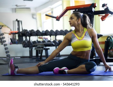 Young athletic indian girl doing aerobics