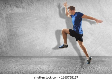 A young athletic man running fast