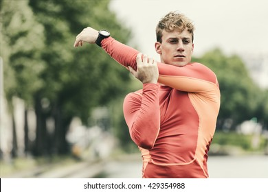 Young athletic man stretching outside