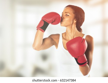 Young athletic woman in boxing gloves