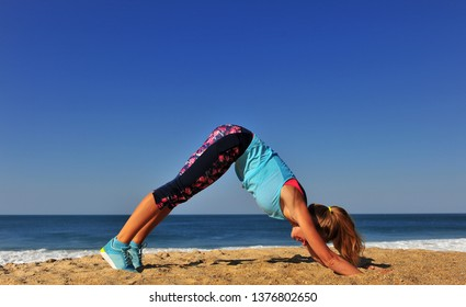 Young athletic woman doing exercise on beach