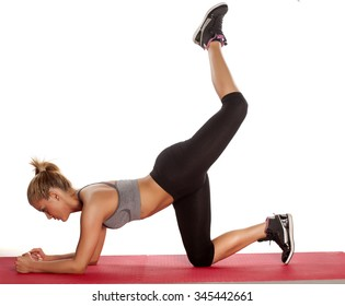 young athletic woman doing exercises for buttocks