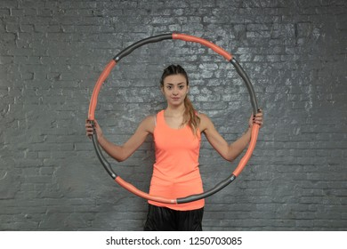 young athletic woman holding a hula hoop
