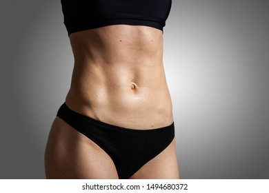 Young athletic woman training abs