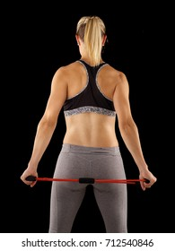 Young atletic woman exercise with elastic fitness