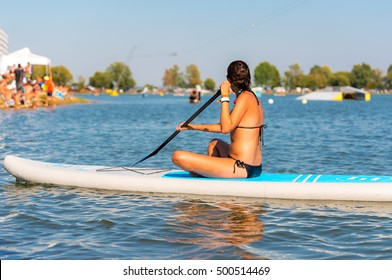 Young atractive and active woman on the paddleboard on the water surface, Nove Mlyny, South Moravia, Czech Republic
