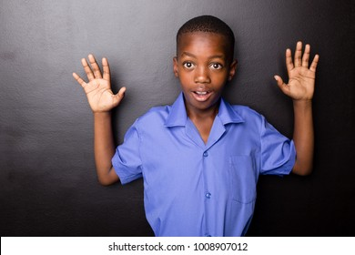 Young atractive black boy wearing school unifor looing sad and worried going to school for the first time with his hands in a hands-up motion.
