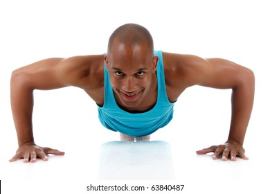 Young attractive African American man athlete doing fitness exercises, push-up. White background. Studio shot.