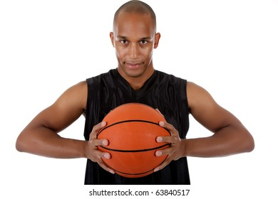 Young attractive African American  man basketball player holding the ball. Studio shot. White background.