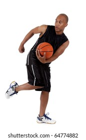 Young attractive African American  man basketball player holding the ball and running. Studio shot. White background.