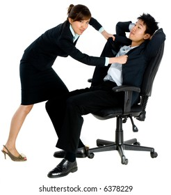 A young attractive Asian businesswoman fighting with a lazy male colleague