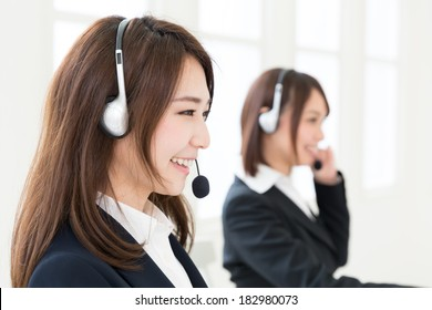 young attractive asian businesswoman with headset
