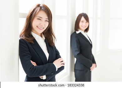 young attractive asian businesswomen