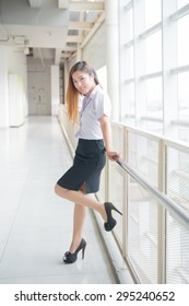 young attractive asian  girl in a uniform of university ,Cute schoolgirl
