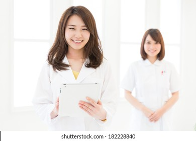 Young attractive asian nurse and doctor