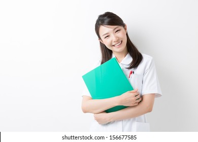 Young attractive asian nurse of the smile