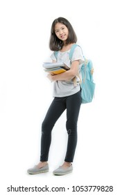 Young attractive Asian student girl holding books on isolated background