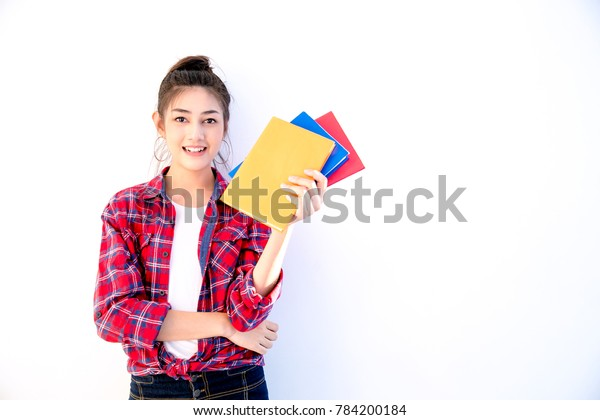 Young Attractive Asian Student Holding Colorful Stock Photo
