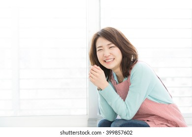 young attractive asian woman dressed in the apron